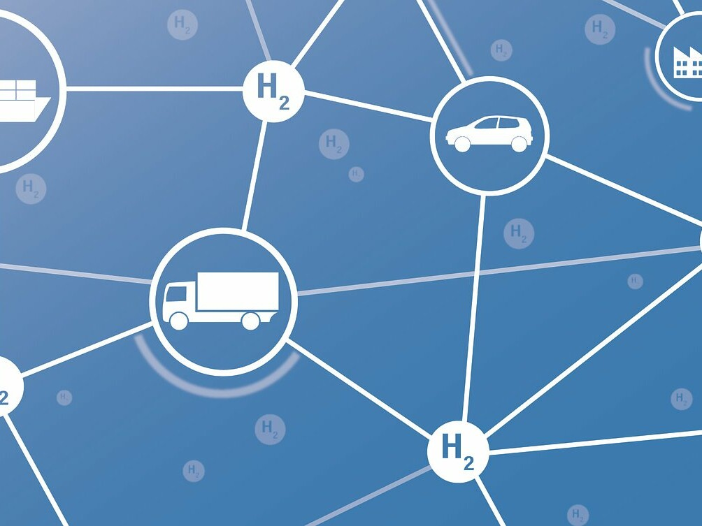 Wasserstoff-Moleküle sind mit Fahrzeugen und Fabriken vernetzt und bilden eine Infrastuktur.